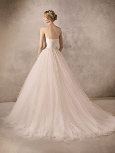 90b62784eb6b Sophisticated princess wedding dress made entirely in off-white tulle. The  layers of the skirt add wonderful volume and the draped sweetheart neckline  and ...